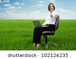 bright picture of smiley secretary on the field showing thumbs up - stock photo