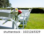 hanging jar of flowers on chair ... | Shutterstock . vector #1021265329