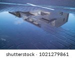 a building reflected in a...   Shutterstock . vector #1021279861