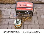 a small red generator on the... | Shutterstock . vector #1021283299
