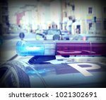 flashing sirens of the police... | Shutterstock . vector #1021302691