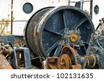 Large metal gears on an industrial tugboat in the ship harbor. - stock photo