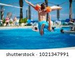 caucasian boy jumping into the... | Shutterstock . vector #1021347991
