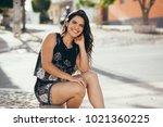 beautiful young woman sitting... | Shutterstock . vector #1021360225