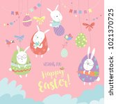 easter bunnies and easter egg | Shutterstock .eps vector #1021370725