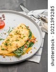 omelet with vegetables on a... | Shutterstock . vector #1021393285