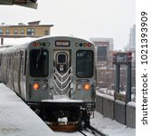 Small photo of A north bound Kimball Brown Line train leaves the Belmont station during a snow storm in Chicago.