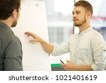 shot of two business colleagues ... | Shutterstock . vector #1021401619