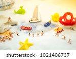 miniature people  sandy beach... | Shutterstock . vector #1021406737