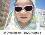 2 year baby boy with hooded... | Shutterstock . vector #1021408585