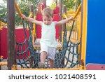 toddler boy walking on blue net ... | Shutterstock . vector #1021408591