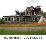 large  unsafe abandoned...   Shutterstock . vector #1021423135