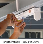 a technician is installing the... | Shutterstock . vector #1021452091
