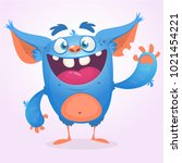 cute furry blue monster. vector ... | Shutterstock .eps vector #1021454221