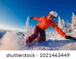 snowboarder on snowboard rides... | Shutterstock . vector #1021463449