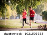 sportive couple running in park | Shutterstock . vector #1021509385