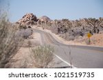road with a car disappearing in ... | Shutterstock . vector #1021519735
