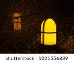 garden light with cross on it... | Shutterstock . vector #1021556839