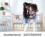 happy young mother playing with ... | Shutterstock . vector #1021565434