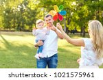 happy family in a park in... | Shutterstock . vector #1021575961