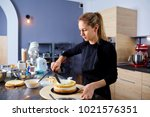 a confectioner woman makes ...   Shutterstock . vector #1021576351