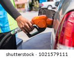 grey car at gas station being... | Shutterstock . vector #1021579111