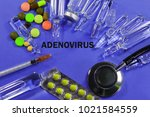 Small photo of Adenovirus. concept of treating the disease. with ampoules, syringe, phonendoscope and tablets