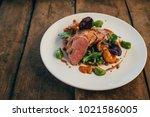 ros  duck breast with broccoli... | Shutterstock . vector #1021586005