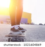 a young hipster girl is riding... | Shutterstock . vector #1021604869