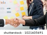 cheerful business men shaking... | Shutterstock . vector #1021605691