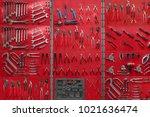professional work tools hanging ... | Shutterstock . vector #1021636474