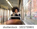 beautiful woman driving on a... | Shutterstock . vector #1021720801