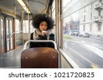 beautiful woman driving on a... | Shutterstock . vector #1021720825