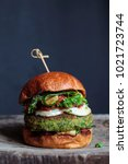 vegetarian burger made of green ... | Shutterstock . vector #1021723744