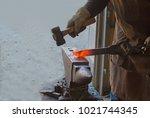 the blacksmith precisely... | Shutterstock . vector #1021744345