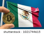 hand holding bitcoin on mexico... | Shutterstock . vector #1021744615