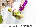 Collective wedding, the bride and holding flowers - stock photo