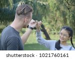 father and daughter in a park ... | Shutterstock . vector #1021760161