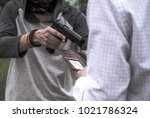 a murderer attacking holding...