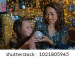 mother and daughter in the home ...   Shutterstock . vector #1021805965