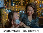 mother and daughter in the home ... | Shutterstock . vector #1021805971