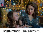 mother and daughter in the home ...   Shutterstock . vector #1021805974