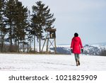 hiking woman is walking to a... | Shutterstock . vector #1021825909