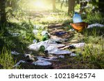 pile of garage on green grass... | Shutterstock . vector #1021842574