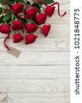 Stock photo roses on old wood background with tag 1021848775