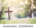 the cross standing on meadow... | Shutterstock . vector #1021855669