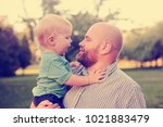 father and son over summer... | Shutterstock . vector #1021883479