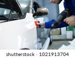 car wrapping specialist putting ... | Shutterstock . vector #1021913704