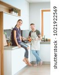 couple cooking together in... | Shutterstock . vector #1021922569