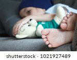 patient kid lie down on couch... | Shutterstock . vector #1021927489